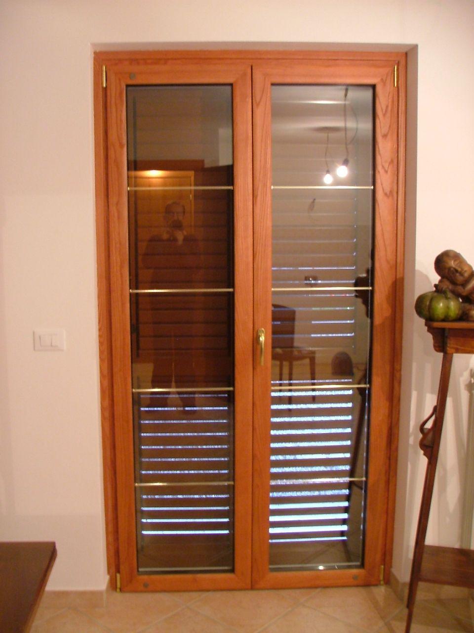 porta finestra soggiorno con angolo cottura